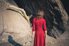 Young woman by cave on the beach Stock Photography