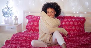 Young woman celebrating alone at Christmas stock footage