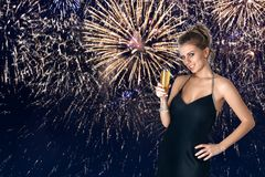 Young woman celebrating with champagne in her hands stock photo