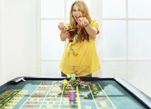 Young Woman Celebrating With Chips At Roulette Table Royalty Free Stock Photo