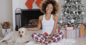 Young woman celebrating Christmas with her dog Stock Photos