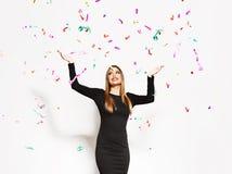 Young woman celebrating, confetti falling stock photo