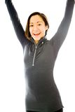 Young woman celebrating with her arms raised Royalty Free Stock Photos