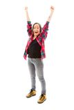 Young woman celebrating with her arms raised Royalty Free Stock Image