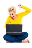 Young Woman Celebrating Success on Laptop Stock Photo