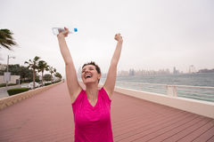 Young woman celebrating a successful training run Royalty Free Stock Photography