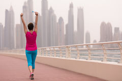Young woman celebrating a successful training run royalty free stock photo