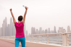 Young woman celebrating a successful training run royalty free stock image