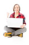 Young woman celebrating with using laptop Royalty Free Stock Images