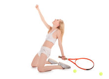 Young woman celebrating after winning a tennis Royalty Free Stock Images