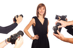 Young Woman Celebrity. Celebrity Woman in front of Paparazzi royalty free stock photography
