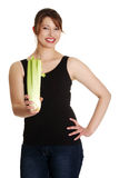 Young woman with celery Stock Photo