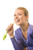 Young woman with celery Royalty Free Stock Images