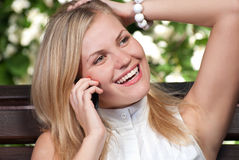 Young woman with cell phone. Royalty Free Stock Photography