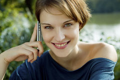 Young woman with a cell phone stock photography