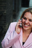 Young woman on cell phone. Young woman talking on cell phone in urban area stock image