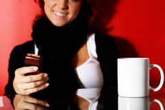 Young woman with cell phone royalty free stock image