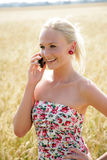 Young woman with cell phone Royalty Free Stock Photo
