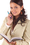 Young woman with cell phone, pen and diary Royalty Free Stock Photos