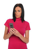 Young Woman with cell phone texting Royalty Free Stock Image