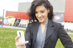Young Woman with cell phone walking Stock Photos