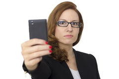 Young Woman with cell phone walking Royalty Free Stock Photo