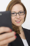 Young Woman with cell phone walking Royalty Free Stock Photos