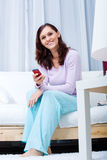 Young woman with cellphone Stock Photography