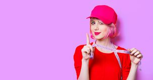Young woman with centimeter royalty free stock images