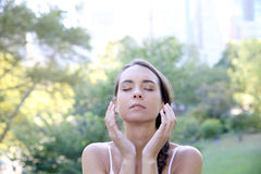 Young woman in central park meditating royalty free stock photography