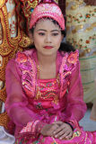 Young woman during a ceremony at the Mahamuni Buddha Temple Royalty Free Stock Photos
