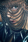 Young woman with chain mask Royalty Free Stock Images