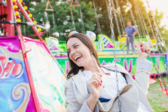 Young woman on chain swing ride, amusement park Stock Image