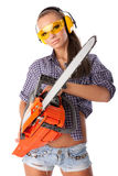 Young woman with a chainsaw. The young woman with a chainsaw on a white background royalty free stock photo