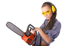 Young woman with a chainsaw Stock Image