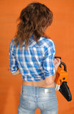 The young woman with a chainsaw Royalty Free Stock Images
