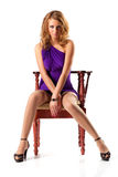 Young woman on a chair Stock Photo