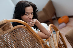 Young Woman in Chair Stock Photo