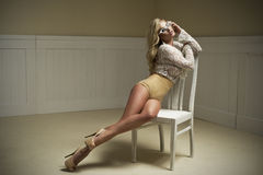 Young woman on chair. Royalty Free Stock Image