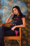 Young woman in chair Royalty Free Stock Photos