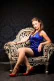 Young woman in a chair royalty free stock photos