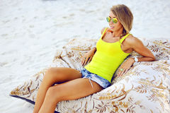 Young woman in chaise lounge at the beach.  royalty free stock photo