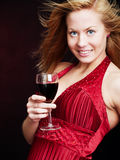 Young woman with champagne over dark Stock Images