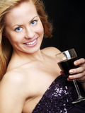 Young woman with champagne over dark Stock Photography