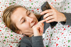 Young woman chat on the smartphone Stock Photography