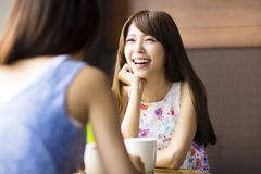young woman chatting in a coffee shop Royalty Free Stock Images