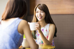 Young woman chatting in a coffee shop Stock Photos