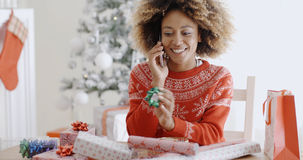Young woman chatting on her mobile at Christmas Stock Image