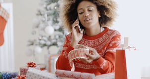 Young woman chatting on her mobile at Christmas Stock Images