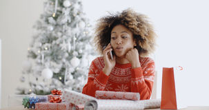 Young woman chatting on her mobile at Christmas Stock Photos